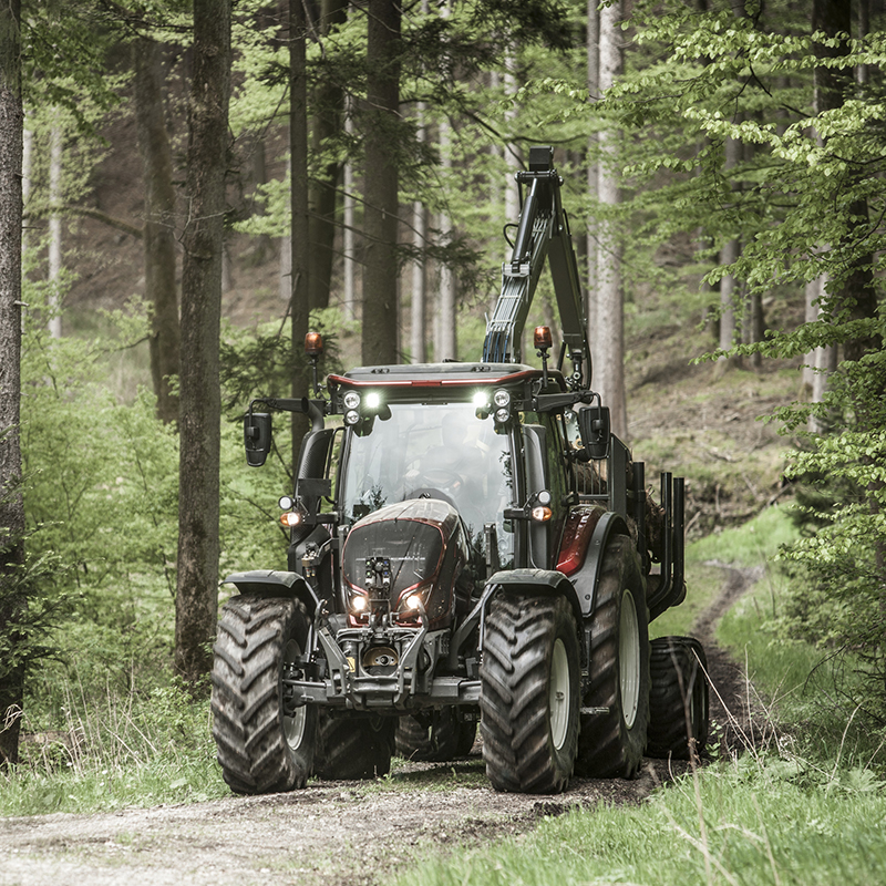valtra unlimited custom tractor at forestry work